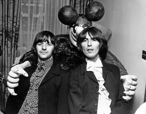 Ringo Starr and George Harrison pose with a Blue Meanie from their film Yellow Submarine on July 8, 1968 in London.