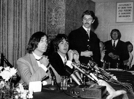 John Lennon and Paul McCartney of the Beatles announce their business venture, Apple Corps, Ltd., at a news conference in New York City on May 14, 1968.