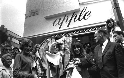 "Tired of being shopkeepers'"" The Beatles' members give away thousands of pounds worth of Apple stock in Baker Street, London, on July 31, 1968."