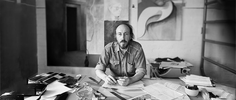 Richard Hamilton seated at a table in his studio at 25 Hurst Ave. in Highgate, London. (1970)