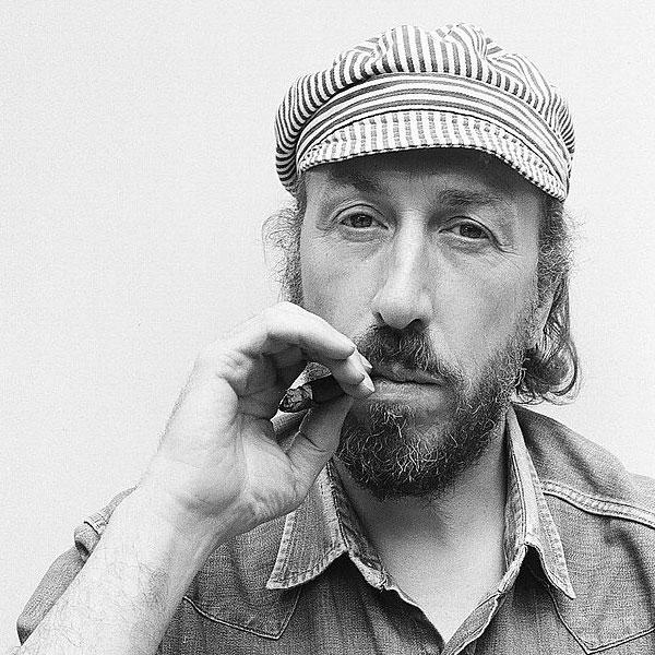 English artist Richard Hamilton posed smoking a cigar in his studio at 25 Hurst Avenue in Highgate, London circa 1970.