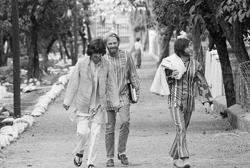 George Harrison, Mike Love, and John Lennon at the ashram near Rishikesh, India. (1968)