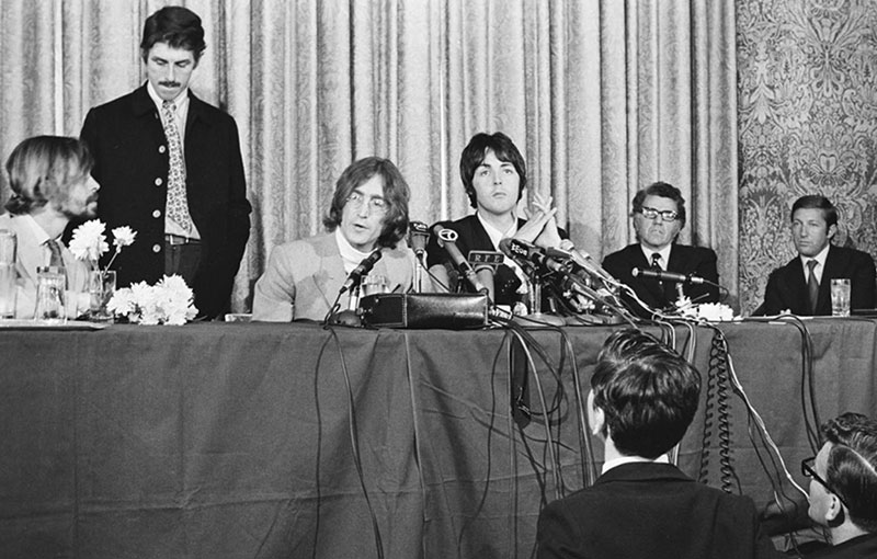 "The Beatles new venture was announced at New York's Americana Hotel on May 14, 1968. Pictured L-R Alexis <em>""Magic Alex""</em> Mardas, Derek Taylor, John Lennon, Paul McCartney, Denis O' Dell and Ron Kass. (photo: © Vincent Vigil)"