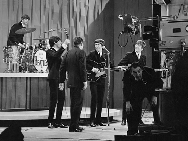 The Beatles speaking backstage with Ed Sullivan in February 1964.